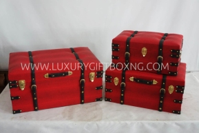 Red Ottoman Trunk box with brown belt detailing